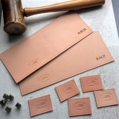 Sparrowhawk Leather NZ hand embossing initials on undyed, full grain, leather