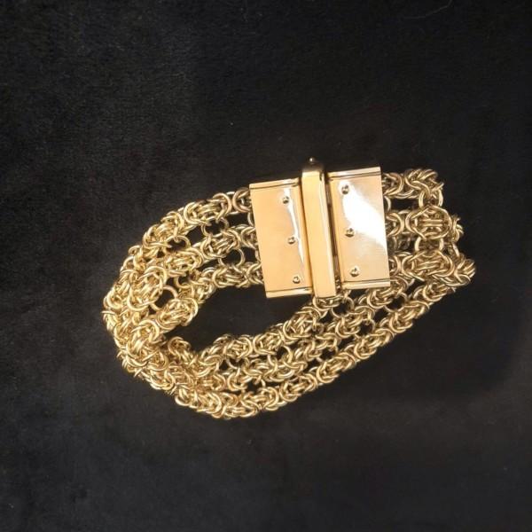 A yellow gold three strand Byzantine weave bracelet